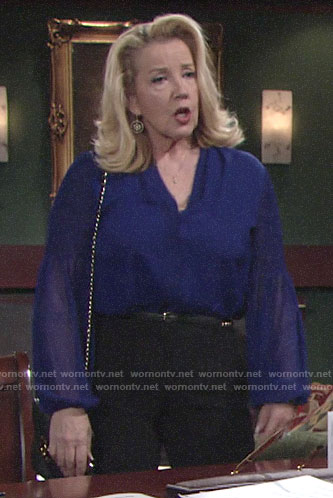 Nikki's blue blouse with smocked sleeves on The Young and the Restless
