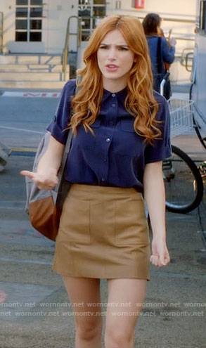 Paige's navy shirt and tan leather skirt on Famous in Love