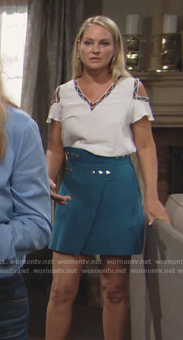 Sharon's white cold-shoulder top and teal wrap skirt on The Young and the Restless