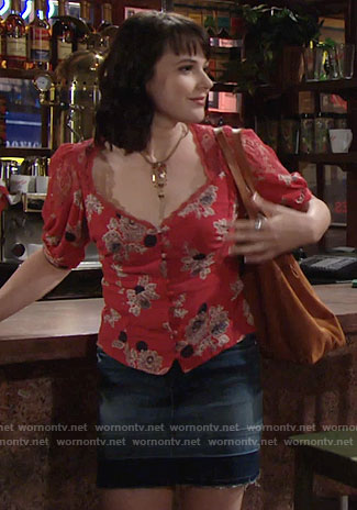 Tessa's red floral top and denim skirt on The Young and the Restless
