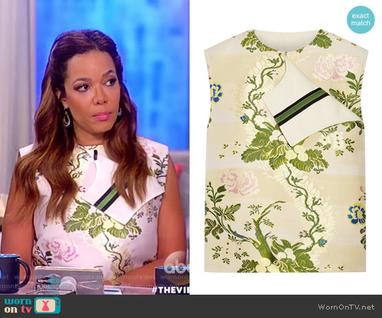 Ribbon-trimmed silk and wool-blend jacquard blouse by Calvin Klein worn by Sunny Hostin  on The View