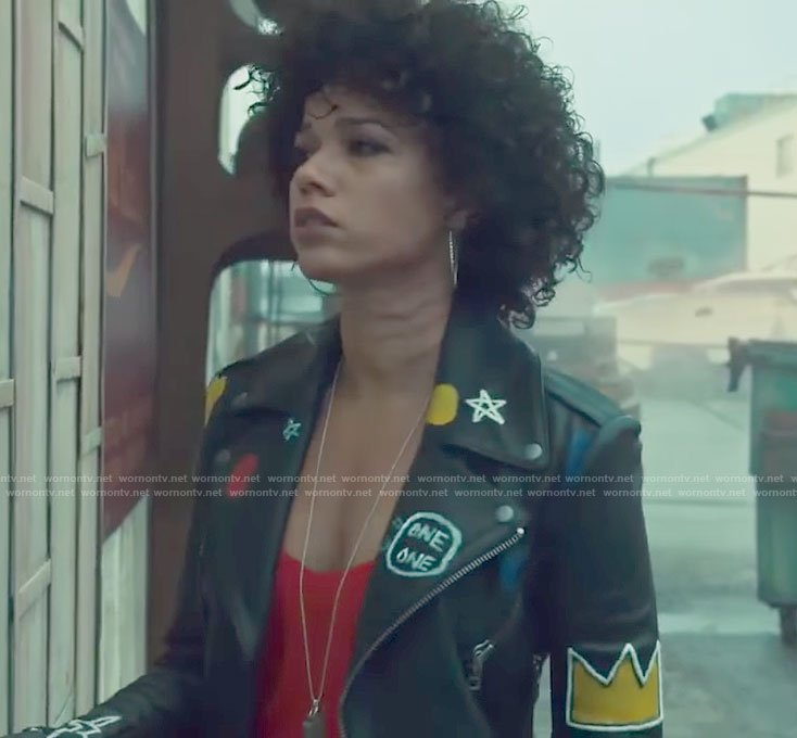 Maia's black graffiti moto jacket and red camisole on Shadowhunters