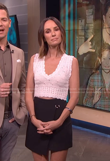 Catt's black wrap mini skirt on E! News