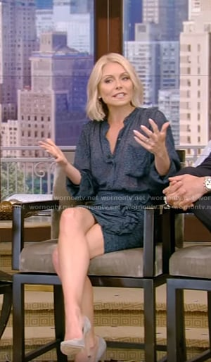 Kelly's blue shirt and ruffled trim mini skirt on Live With Kelly