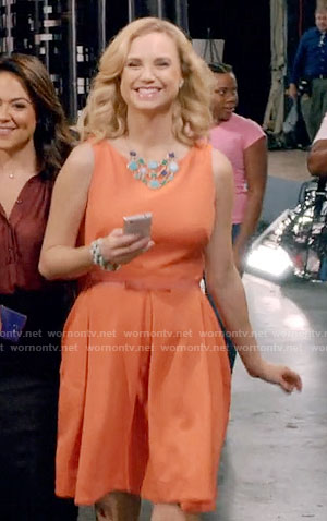 Heather's orange dress with bow belt on Daytime Divas