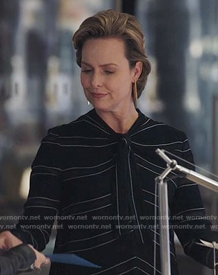 Jacqueline's black striped tie-neck top on The Bold Type
