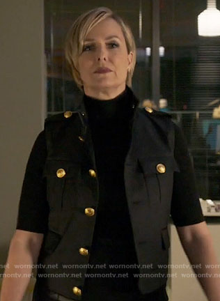 Jacqueline's black vest with gold buttons on The Bold Type