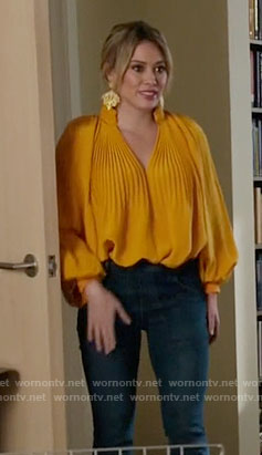 Kelsey's yellow pleated blouse on Younger