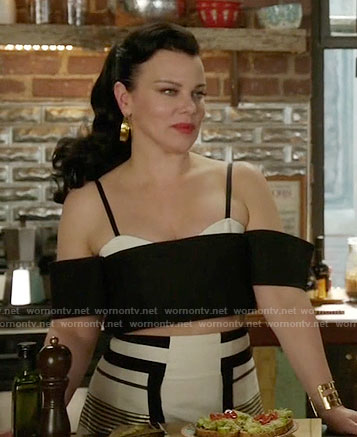 Maggie's black and white crop top and gold striped skirt on Younger