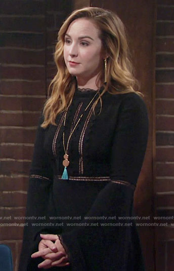Mariah's black bell-sleeve dress and blue tassel necklace on The Young and the Restless