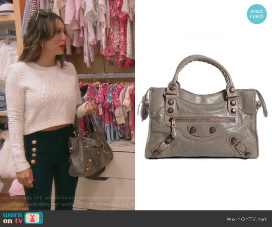 Small City Bag by Balenciaga worn by Kelly Dodd on The Real Housewives of Orange County