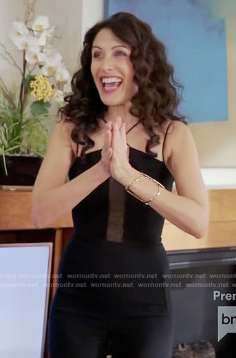 Abby's black criss-cross strap jumpsuit on Girlfriends Guide to Divorce