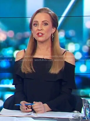 Carrie's black cold shoulder ruffle top on The Project