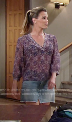 Chelsea's purple v-neck top and denim skirt on The Young and the Restless