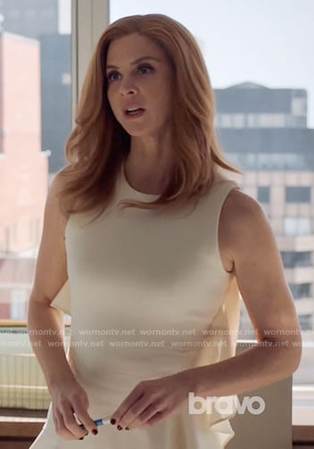 Donna's white ruffled dress on Suits