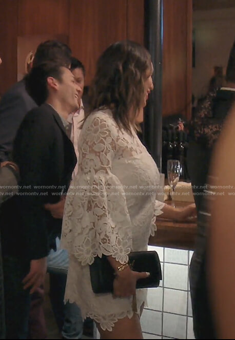 Kelly's white lace bell sleeve dress on The Real Housewives of OC