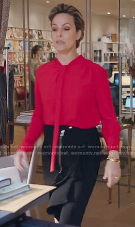 Jacqueline's red blouse and black ruffled skirt on The Bold Type