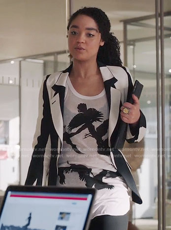 Kat's black and white bird print top and striped jacket on The Bold Type