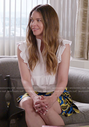Liza's white ruffled shirt and leaf print skirt on Younger