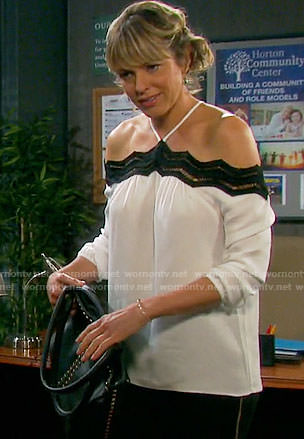 Nicole's white top with black lace trim on Days of our Lives