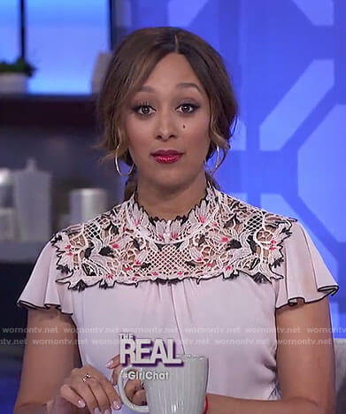 Tamera's nude floral embroidered top and jeans on The Real