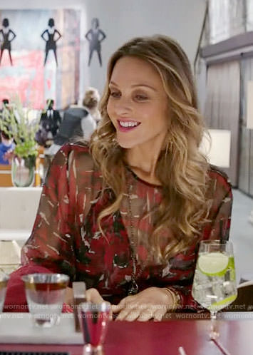 Phoebe's red and black printed dress on Girlfriends Guide to Divorce