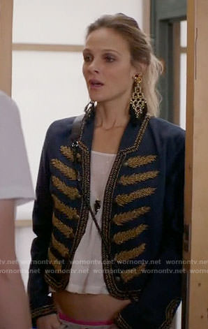 Phoebe's blue jacket with gold embroidery and black tassel earrings on Girlfriends Guide to Divorce