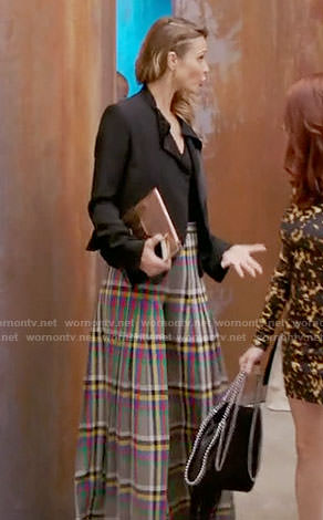 Phoebe's plaid wide-leg trousers on Girlfriends Guide to Divorce