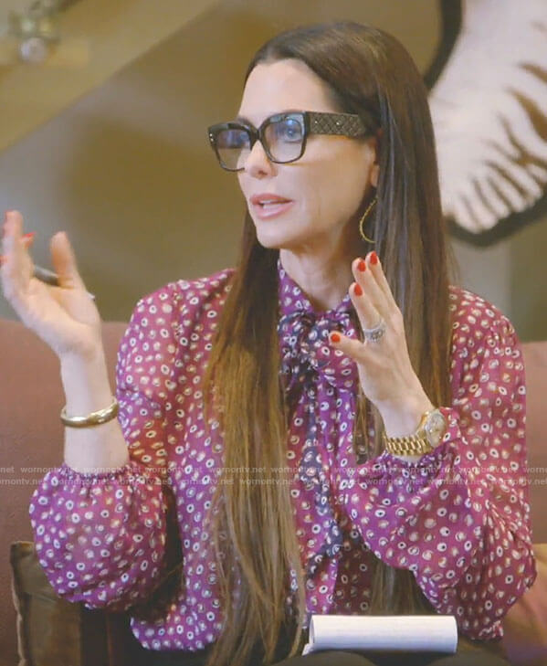 D'Andra's purple dotted tie blouse on The Real Housewives of Dallas