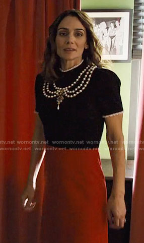 Sam's black and red dress with pearls on Friends from College