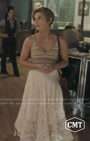 Scarlett's beige knitted top and white midi skirt on Nashville