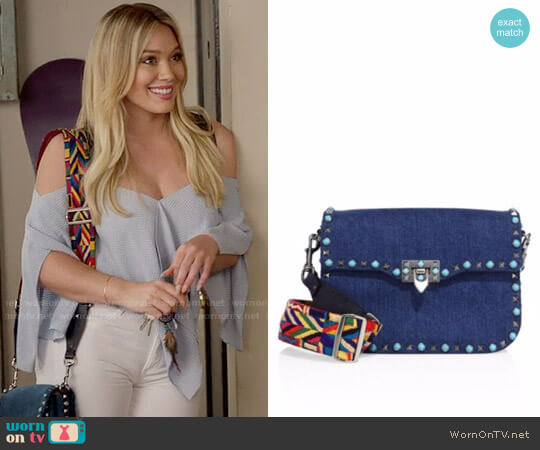 Valentino Rockstud Rolling Denim Guitar-Strap Shoulder Bag worn by Kelsey Peters (Hilary Duff) on Younger