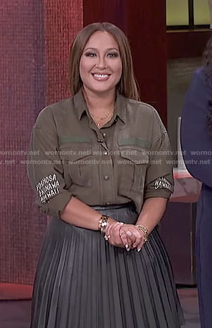 Adrienne's khaki shirt and black pleated skirt on The Real