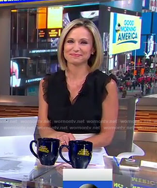 Amy's black ruffle shoulder top and white skirt on Good Morning America