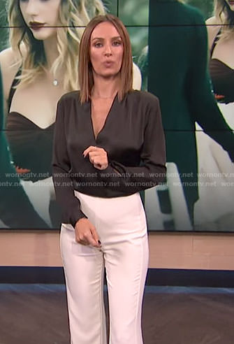 Catt's black crossed front top and white slit pants on E! News
