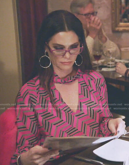 D'Andra's pink zig zag print top on The Real Housewives of Dallas