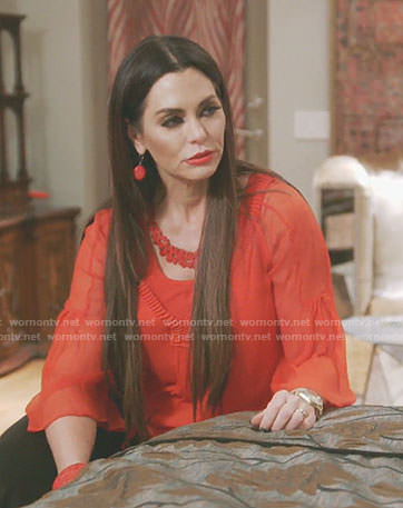 D'Andra's red pleated neck sheer top on The Real Housewives of Dallas