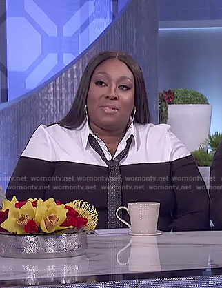 Loni's black layered blouse and checked pants on The Real