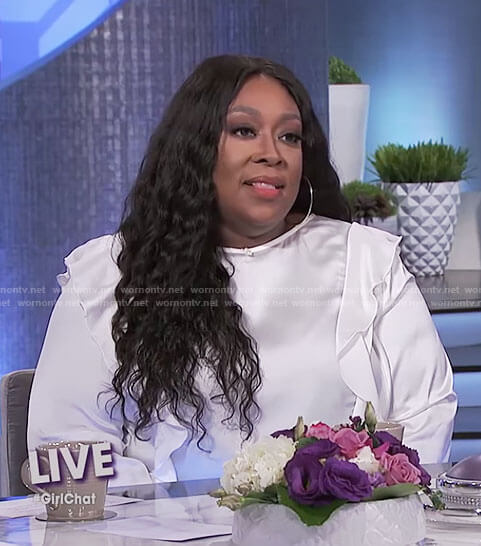 Loni's white ruffle top on The Real