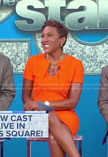 Robin's orange folded neck dress on Good Morning America