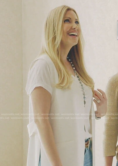 Stephanie's white long vest on The Real Housewives of Dallas