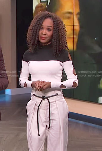 Zuri's white color-block cutout sleeve top and belted pants on E! News