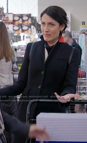 Abby's black coat with red collar on Girlfriends Guide to Divorce