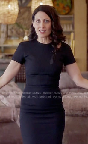 Abby's black funeral dress with shoulder cutout on Girlfriends Guide to Divorce