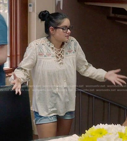 Alex's cream embroidered lace-up top on Modern Family