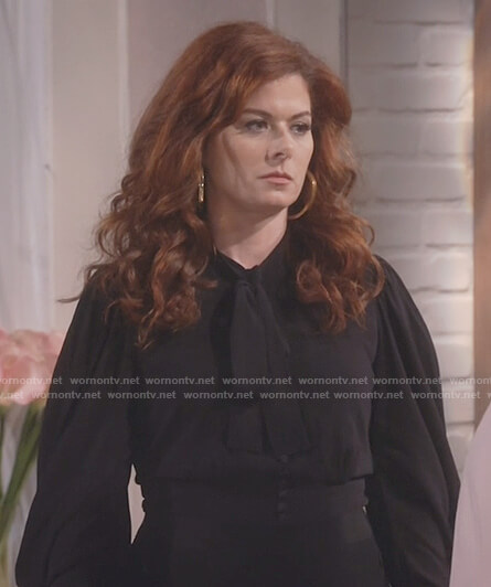 Grace's black bow neck long sleeve top on Will and Grace