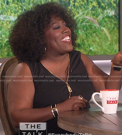 Sheryl's black sleeveless zip front top on The Talk