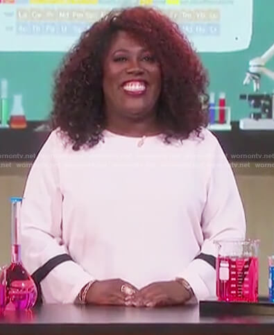 Sheryl's pink ribbon sleeve top on The Talk