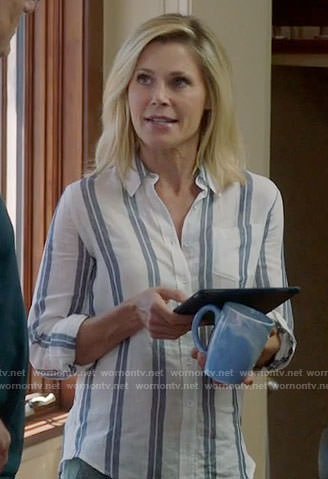 Claire's blue striped button front shirt on Modern Family