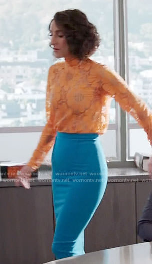 Delia's orange floral top and blue pencil skirt on Girlfriends Guide to Divorce